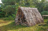 Primitive fisher shed in the wood