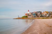 Urk Netherlands, fishing village with lighthouse on a calm winter day at the beach