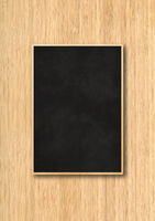 Traditional black board isolated on a wooden background