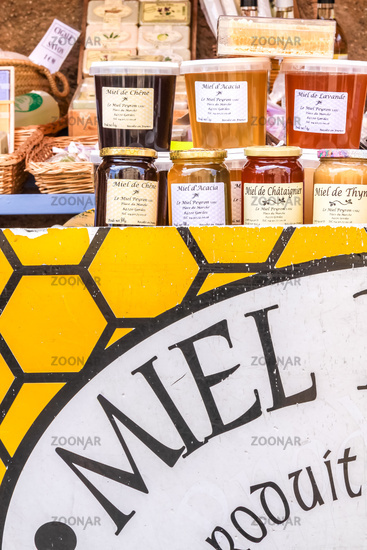 Stand with honey in the market in Gordes
