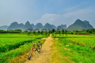 biking on Li river mountain landscape in Yangshuo Guilin