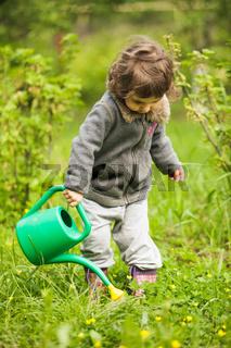 Little kid in the garden
