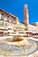 Piazza delle erbe in Verona street and market view with Lamberti tower
