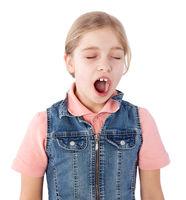young girl yawning