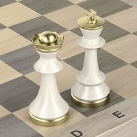 Queen and king chess pieces on chess board