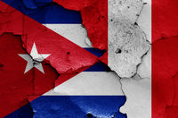 flags of Cuba and Peru painted on cracked wall