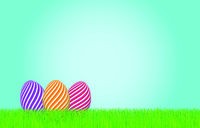 Striped Easter eggs in the grass.