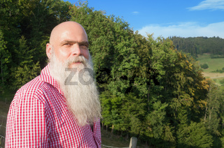 white bearded man in the forest