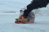 burning Icebreaker ship in the sea of Antarctic