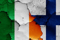 flags of Ireland and Finland painted on cracked wall