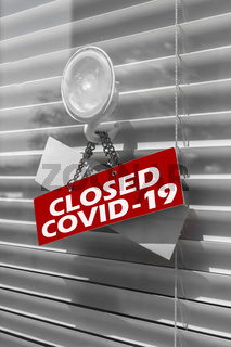Closeup of information sign 'Closed due to covid-19'
