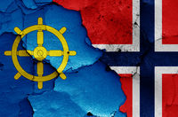 flags of Bamble and Norway painted on cracked wall