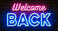 Neon sign on a brick wall - Welcome back