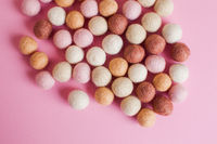 Close up felt balls in pastel colours