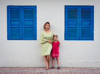 Mother and daughter in a street