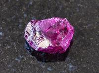 unpolished Rhodolite (pyrope) crystal on black