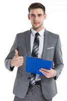 Businessman with giving thumb up