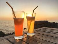 Frozen cocktail glasses over sunset
