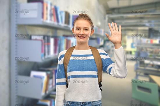 smiling teenage student girl with school bag