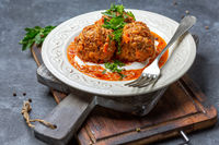 Minced meat meatballs with vegetables and tomato sauce.