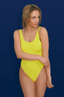 Beautiful sexy young woman in yellow swimsuit