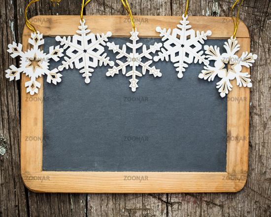 Snowflakes border on wood blackboard blank