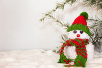 snowmen made with wool pompoms, on a Christmas background
