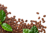 Spilled Coffee Beans With Green Leaves Isolated