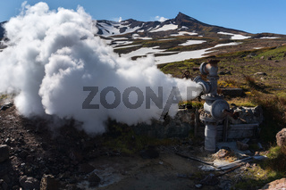 Natural mineral thermal steam-water emission from well, geothermal deposit area