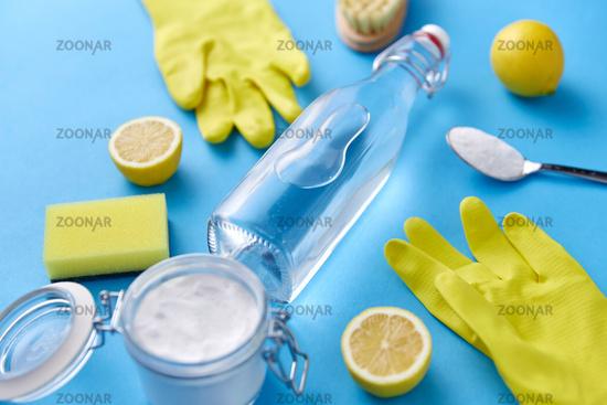 vinegar, lemons, washing soda, gloves and brush