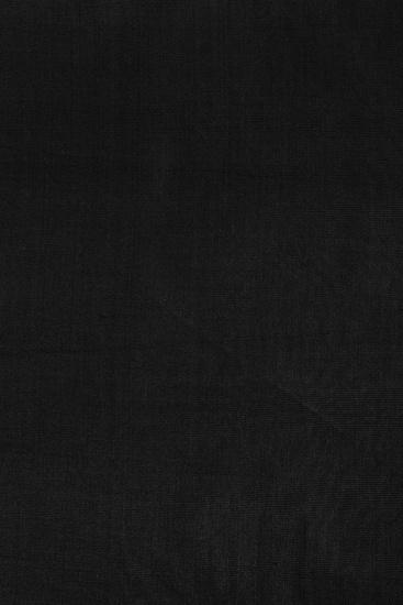 Black fabric background.