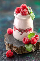 Healthy berry yogurt with fresh raspberries.