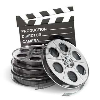 Movie concept. Film reels and clapboard
