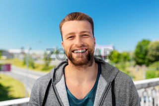 portrait of happy smiling young man outdoors