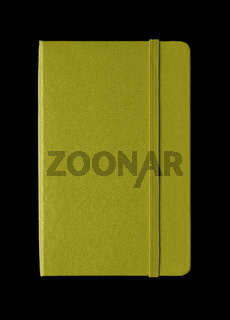 Olive green closed notebook isolated on black