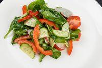 Vegetable salad on white plate