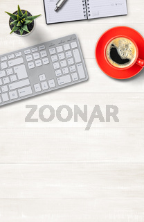 Top view of a workplace with office supplies  on a wooden background