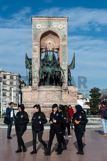 Turkish female police with and without hijab Taksim square, Istiklal Street, Istanbul, Turkey.