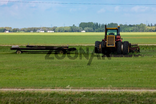 Tractor and work machinery in farm field