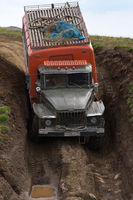 Russian off-road extreme expedition truck Ural driving dirty muddy mountain road