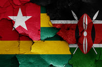 flags of Togo and Kenya painted on cracked wall