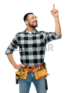 happy male worker or builder with tool belt