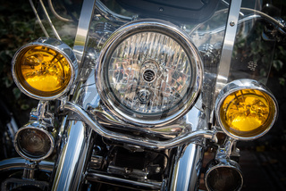 Details of a shiny Harley Davidson front headlights