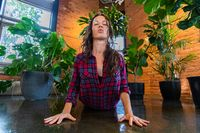 Healthy woman during flowing yoga class