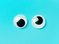 googly eyes on turquoise background