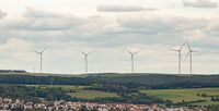 Wind power generators on a background of cloudy sky.