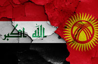 flags of Iraq and Kyrgyzstan painted on cracked wall