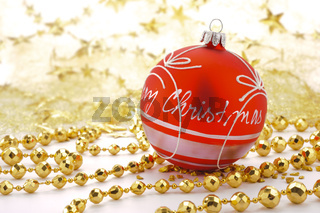 Xmas decoration with red christmas ball on golden pearl necklace
