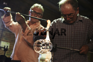 Glassmakers, Glassblowers forming molten glass