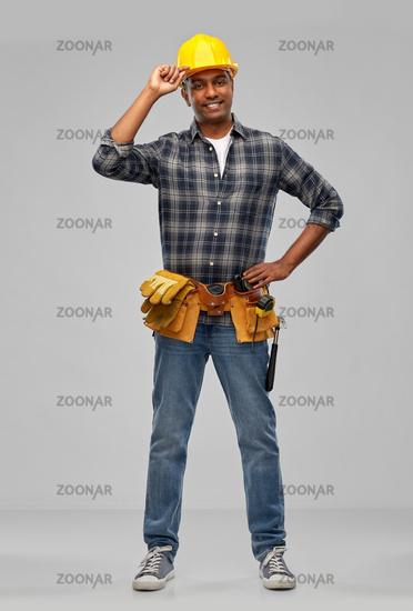 happy indian builder in helmet with tool belt